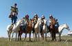 Reitertruppe im Gegentala-Grasland (Innere Mongolei) – ©  Stefan Schomann